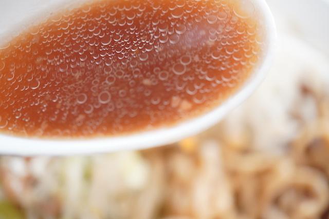 レンゲに入ったスープ